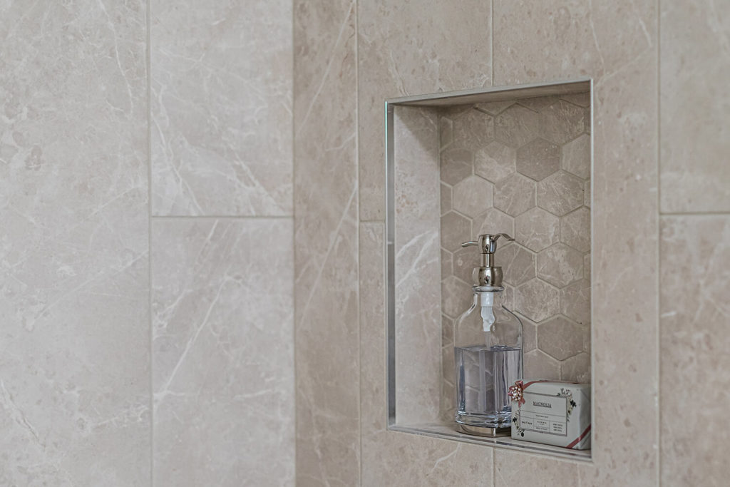 Bathroom niche with greige geometric flattened hex tile