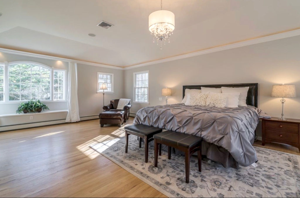 Designed to sell, taupe traditional master bedroom